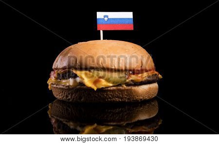 Slovenian Flag On Top Of Hamburger Isolated On Black Background