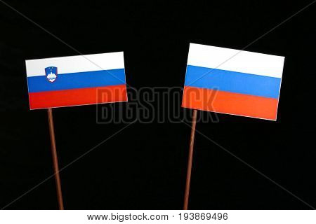 Slovenian Flag With Russian Flag Isolated On Black Background