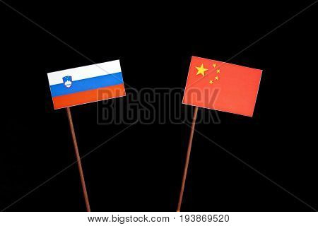 Slovenian Flag With Chinese Flag Isolated On Black Background