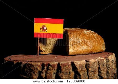 Spanish Flag On A Stump With Bread Isolated