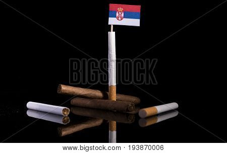 Serbian Flag With Cigarettes And Cigars. Tobacco Industry Concept.
