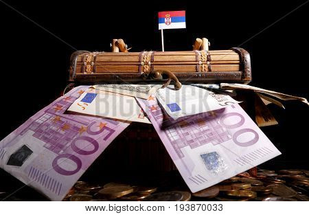 Serbian Flag On Top Of Crate Full Of Money