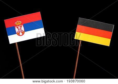 Serbian Flag With German Flag Isolated On Black Background