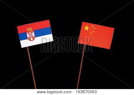 Serbian Flag With Chinese Flag Isolated On Black Background