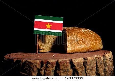 Suriname Flag On A Stump With Bread Isolated