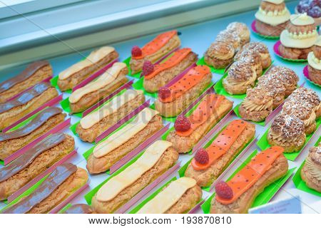 Different french cookies biscuit eclair chocolate macaroon raspberries