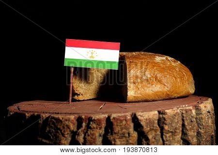 Tajikistan Flag On A Stump With Bread Isolated