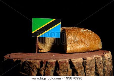 Tanzanian Flag On A Stump With Bread Isolated