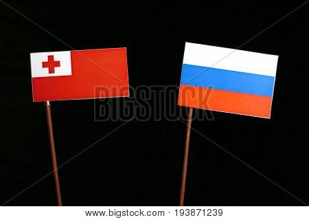Tongan Flag With Russian Flag Isolated On Black Background