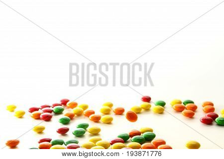 Sweets background / A variety of bite-sized chewy candies with a colorful candy shell