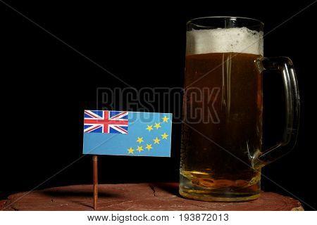 Tuvalu Flag With Beer Mug Isolated On Black Background