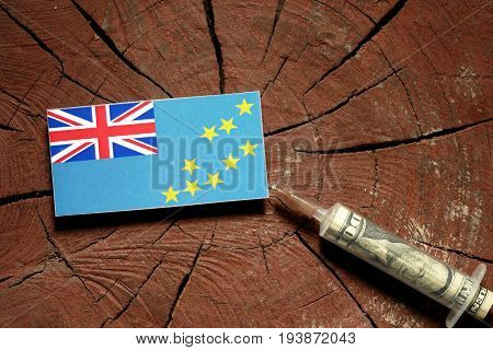 Tuvalu Flag On A Stump With Syringe Injecting Money In Flag