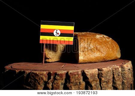 Uganda Flag On A Stump With Bread Isolated