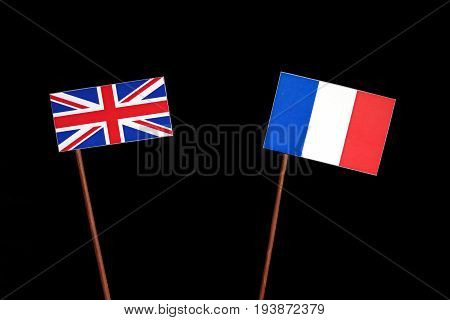 British Flag With French Flag Isolated On Black Background