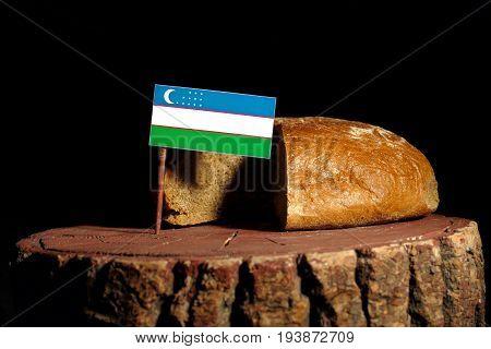 Uzbekistan Flag On A Stump With Bread Isolated