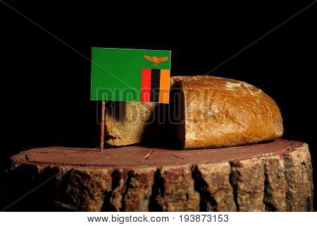 Zambia Flag On A Stump With Bread Isolated