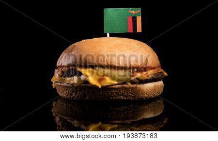 Zambia Flag On Top Of Hamburger Isolated On Black Background