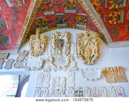 Padua, Italy - September 19, 2014: Wall with bas-reliefs at Palazzo Bo, historical building home of the Padova University from 1539, in Padua, Italy on September 19, 2014: