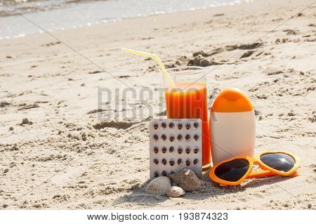 Medical Pills, Carrot Juice And Accessories For Sunbathing, Vitamin A And Beautiful, Lasting Tan