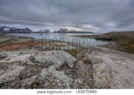 clouds over arctic landscape on an island of svalbard