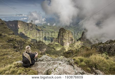 Gondar Ethiopia October 5th 2014: hiker resting and looking at the view in Simien mountain