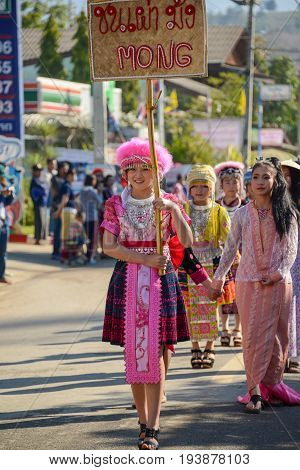 CHIANGMAI THAILAND - JANUARY 25 2015: Hill Tribe girl holding board of the indigenous name in the parade of 22nd Traditional Skirt Fabric and The Indigenous Product and Culture Festival in Mae Chaem of Chiangmai Thailand