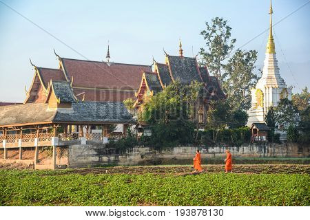 CHIANGMAI THAILAND - JANUARY 25 2015: Buddist monks getting back temple after seeking alms. This is usual every day duty of Buddhist monks.