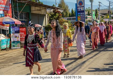 CHIANGMAI THAILAND - JANUARY 25 2015: Multi indigenous peoples in parade of 22nd Traditional Skirt Fabric and The Indigenous Product and Culture Festival in Mae Chaem Chiangmai Thailand