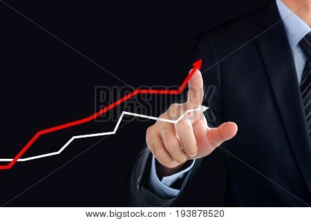Businessman hand touching rising graph on virtual screen - business financial and investment success concepts