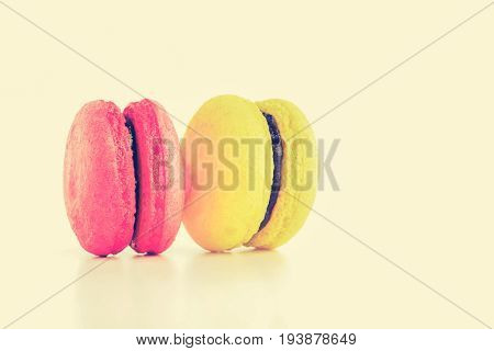 Macarons French confection in vintage tone with copy space - colorful food and dessert concept