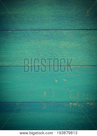 Weathered old wooden plank in vintage blue using as background