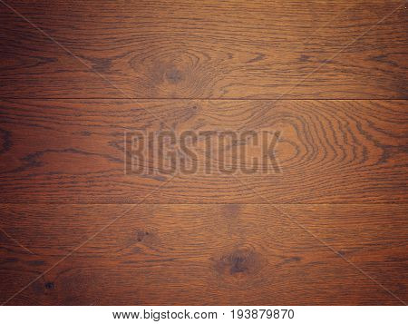 Old used oak plank using a background wooden texture with space for text or image