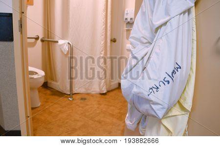 Laundry bag hanging on a hospital bathroom door