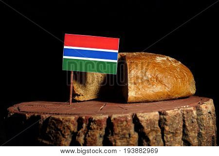 Gambian Flag On A Stump With Bread Isolated