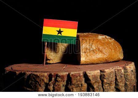 Ghanaian Flag On A Stump With Bread Isolated