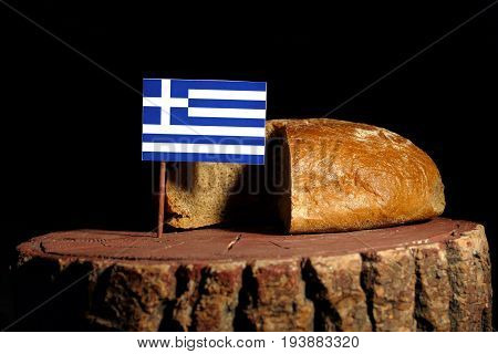 Greek Flag On A Stump With Bread Isolated