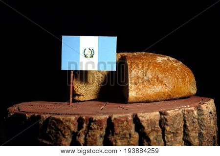 Guatemalan Flag On A Stump With Bread Isolated