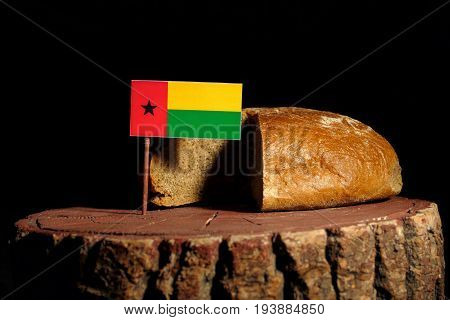 Guinea Bissau Flag On A Stump With Bread Isolated