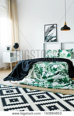 Floral design of bedding in modern decorated bedroom