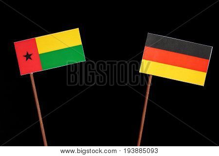 Guinea Bissau Flag With German Flag Isolated On Black Background