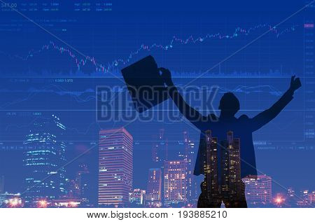 Silhouette of successful businessman trader holding hands and briefcase with picture chart of stock market investment trading Forex graph and view of business city center background Double exposure.