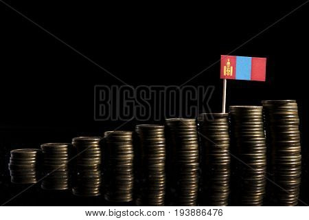 Mongolian Flag With Lot Of Coins Isolated On Black Background