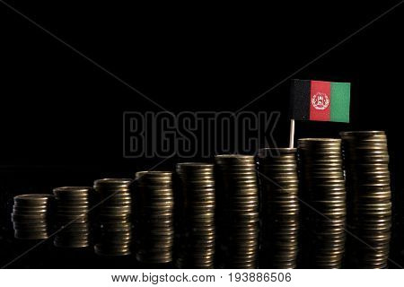 Afghani Flag With Lot Of Coins Isolated On Black Background