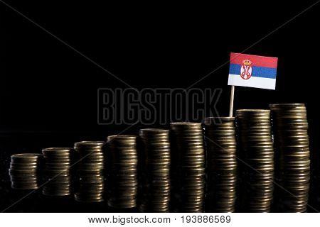 Serbian Flag With Lot Of Coins Isolated On Black Background