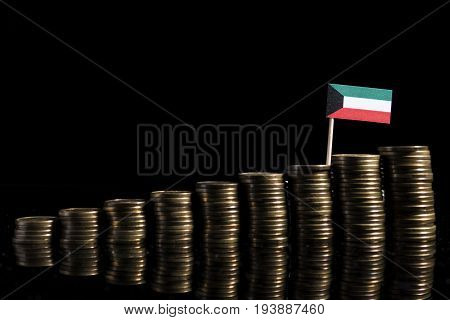 Kuwaiti Flag With Lot Of Coins Isolated On Black Background