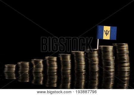 Barbados Flag With Lot Of Coins Isolated On Black Background