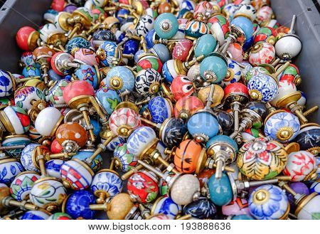 Round Ceramic Furniture Handles For Doors Or Kitchen Cabinets Sold At Local Market. France
