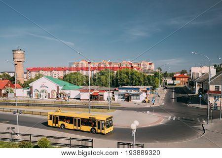 Brest, Belarus - June 6, 2017: Yellow Public Bus Is At Bus Stop Near Brest Central, Brest-Tsentralny Railway Station In Sunny Summer Day.