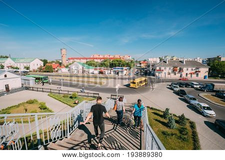Brest, Belarus - June 6, 2017: People Rush On Pedestrian Crossing Bridge To Bus Stop Near Brest Central, Brest-Tsentralny Railway Station In Sunny Summer Day.