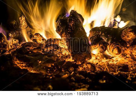 Smoldering embers in the fire at night